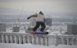 Sebastien-Toutant-Snowboarding-in-Downtoan-Montreal